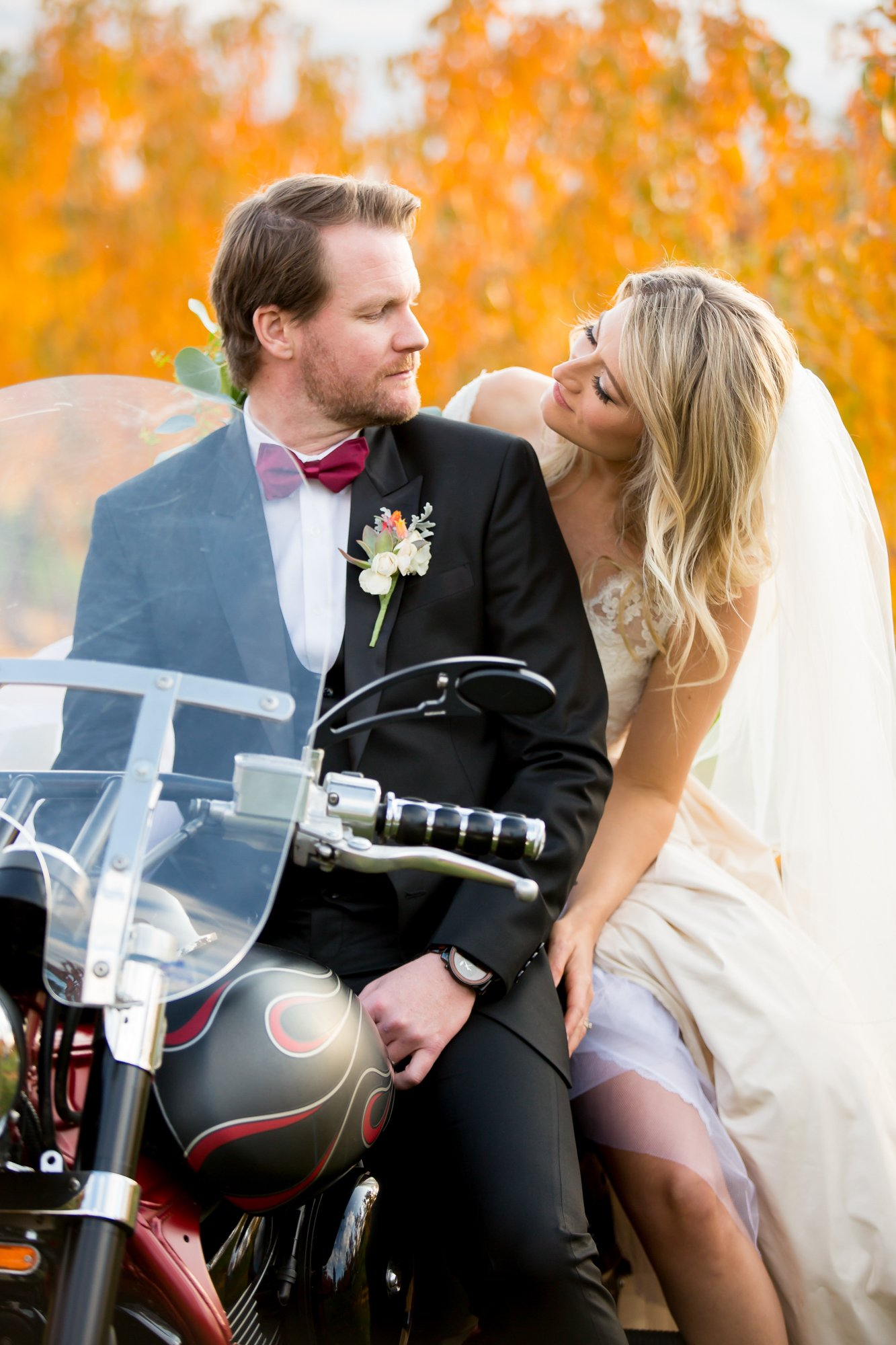 A couple sitting otgether on a motorbike