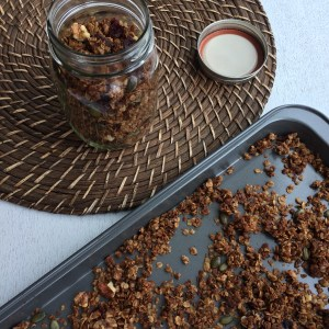 image of granola in a jar and on a baking sheet