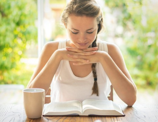 Woman reading Bible looking for assurance about Once Saved Always Saved doctrine