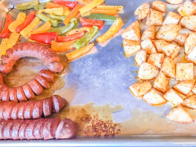 Kosher Sausage and Peppers prepared on a sheetpan with Potatoes and Honey Mustard