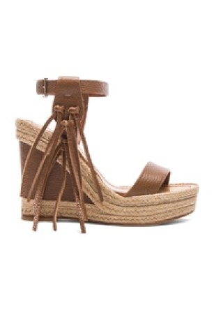 Celeb Fashion Find: Amal Clooney's gorgeous Valentino C-Rockee Leather Fringe Wedge Sandals in Brown Light Cuir. Forward by Elyse Walker
