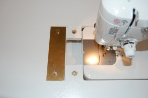 Here the brass plate is flipped over - you can see the magnets coutner sunk and plenty of room to access the bobbin.