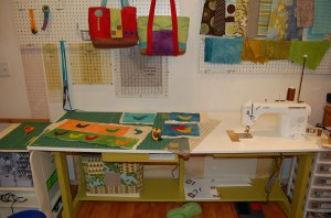 """With the """"mini-table"""" in place, I can use the surface for cutting, or it will support a large quilt when I'm quilting."""