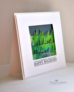 Moxie Fab World - The Holiday Cards Challenge. Die-Cut Pine Tree Border (Memory Box) from Distress Ink Panel. ©Candles in the Garden