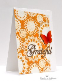 ©Candles in the Garden. RIC74. Inlaid die-cutting and embellished butterfly (Wink of Stella and Glossy Accents).