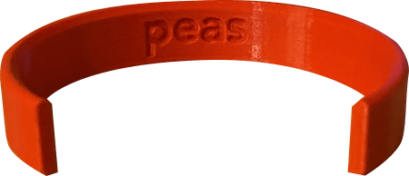 detailed view of the inside of a peas CanDo label with the word peas in large engraved text