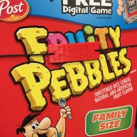 front of a Fruity Pebbles box with an elastic holding a CanDo box label to the surface