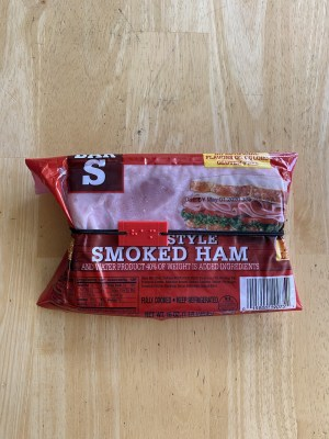 pack of ham with reusable braille label held on by elastic