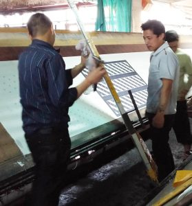 Part of the tie manufacturing process: screen printing