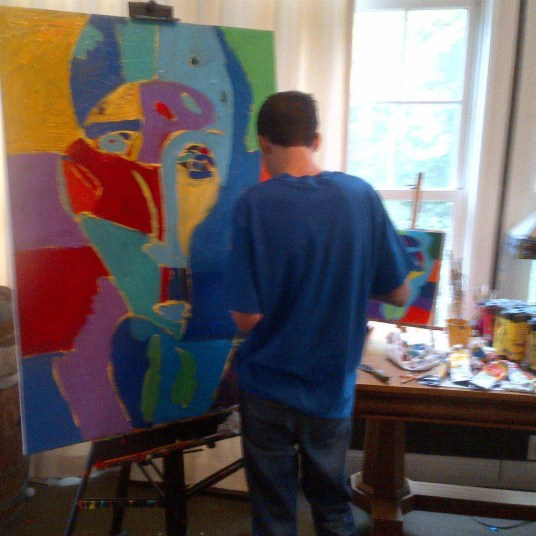 "Artist Jimmy Reagan working on his painting ""Man of the World"""