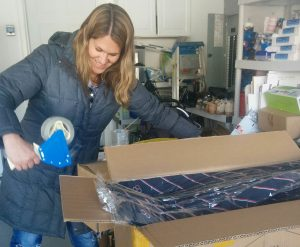 Becky hard at work packing up an order