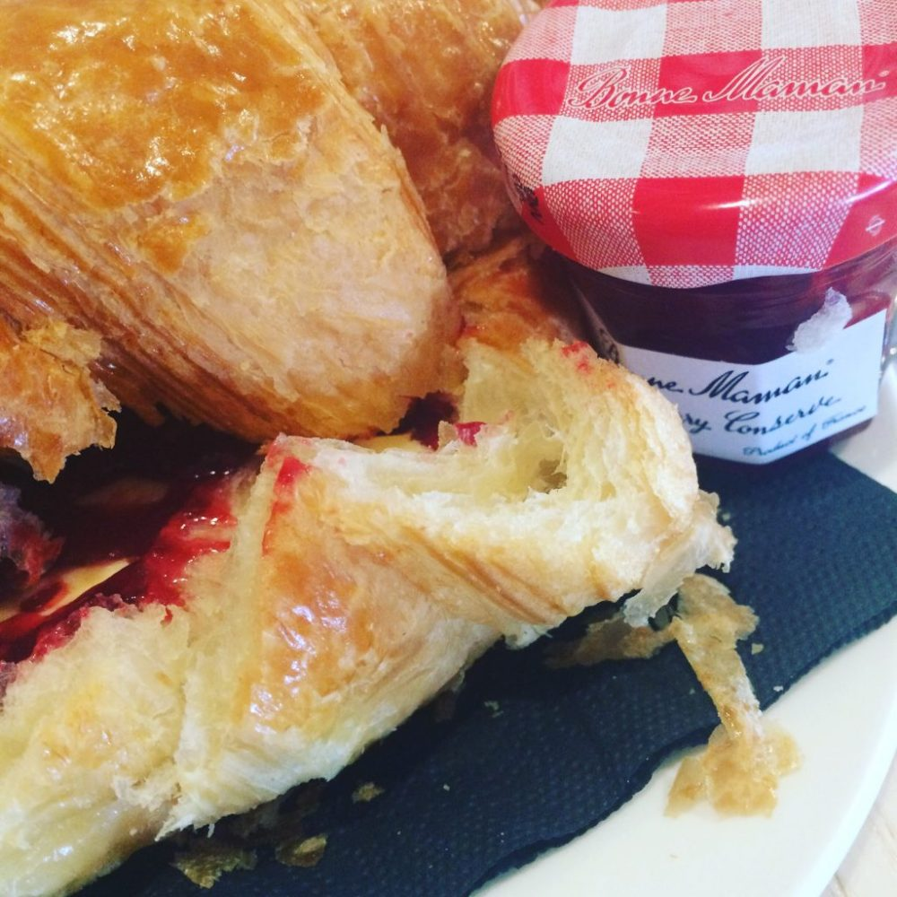 urban meadow cafe brunch, croissant with jam and butter