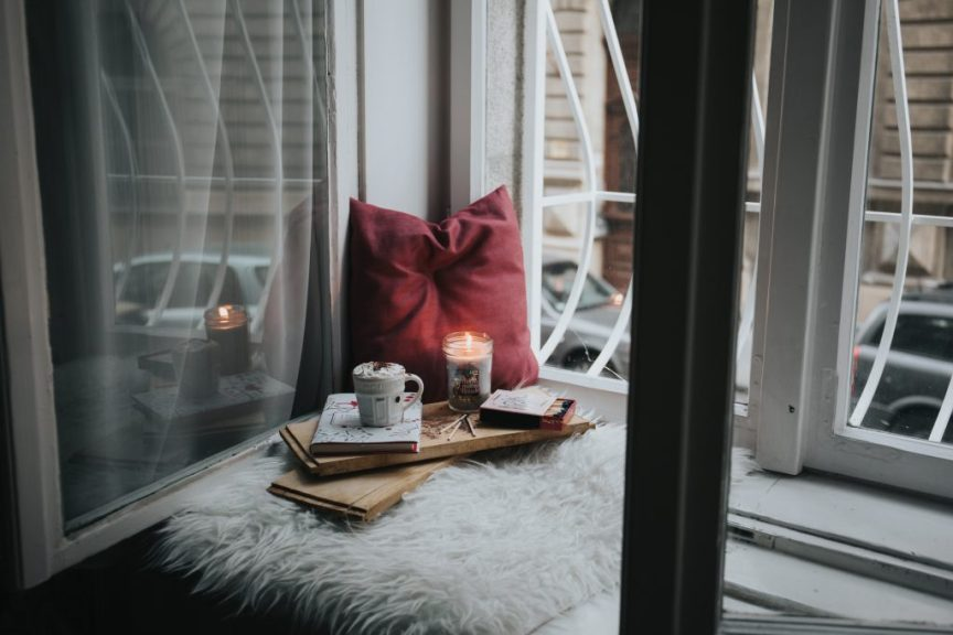 Relaxing by the window with a coffee and candle. If you want to induce labour it's important to take time to relax
