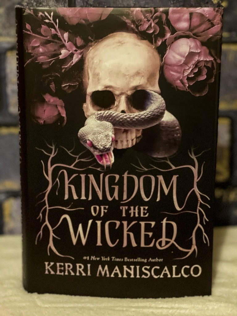 a hardback copy of kingdom of the wicked