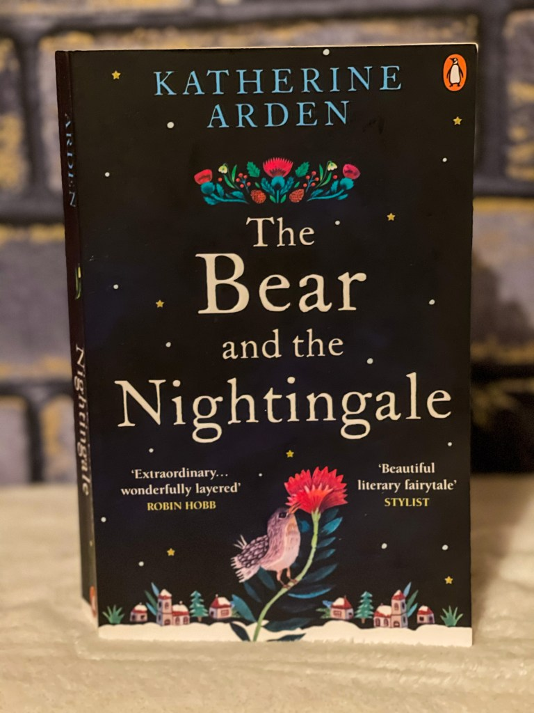 the bear and the nightingale paperback against a grey brick background