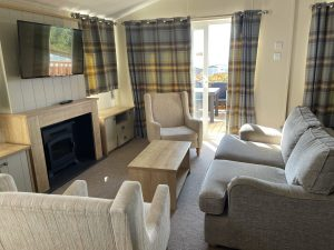 freshwater holiday lodge living room at nodes point holiday park