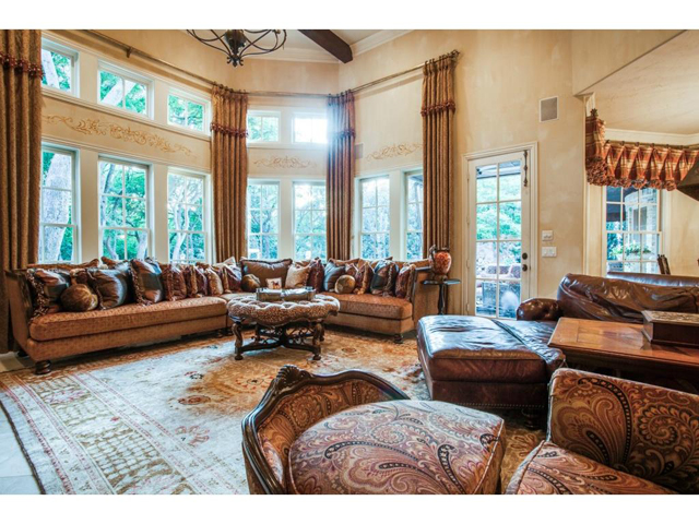 Stunning great room boasts vaulted beamed ceiling and a wall of