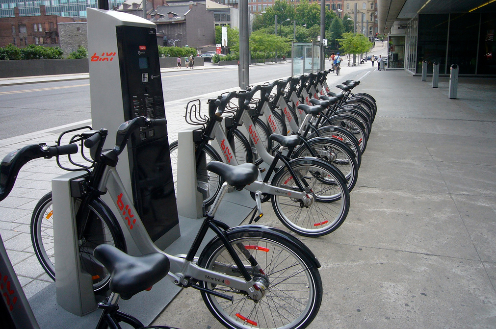 a line of bikes apart of a sharing program