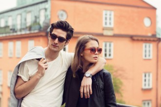 Couple wearing Triwa sunglasses and watch