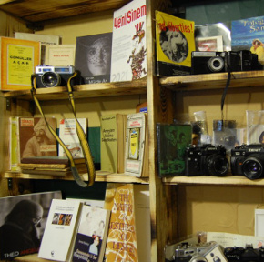 Shelves of books and cameras at Fahrenheit451 Recycling store