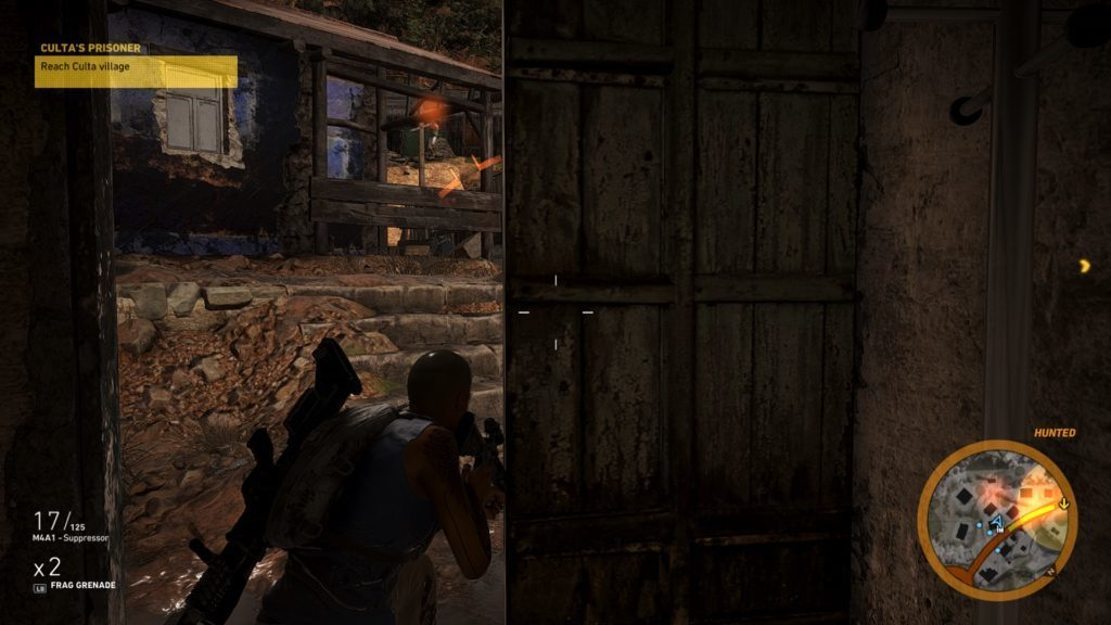 Player hiding in dark building with red indicator that a nearby enemy has spotted her.