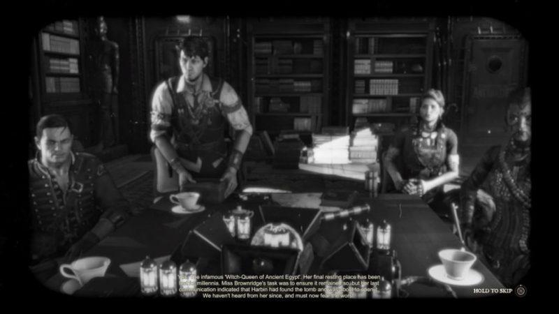 Black and white scene of Strange Brigade crew. Illegible subtitles shown at bottom.
