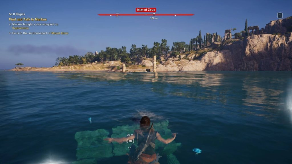 Kassandra swimming near ruins. Island in background.