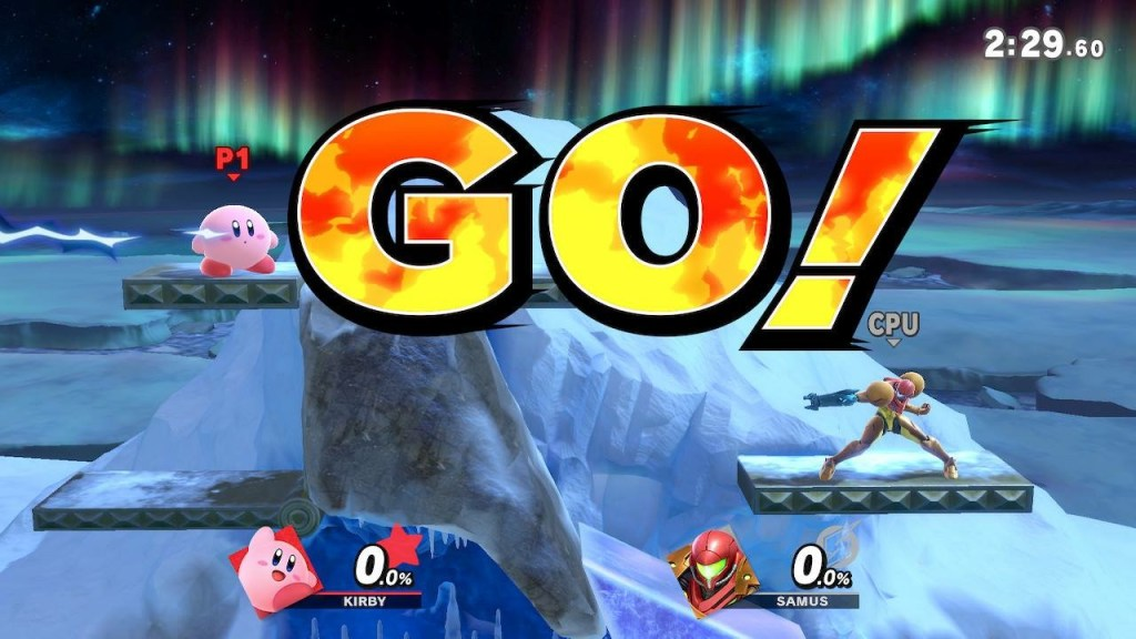 """Kirby and Samus in a Super Smash Bros. Ultimate match. Fight stage is an iceberg with big bits of ice in the background. Announcer call-out """"GO!"""" is displayed on the screen."""