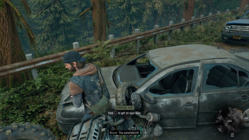 Deacon standing next to a broken down car with his motorcycle upside down. Hard to see tool-tips shown.