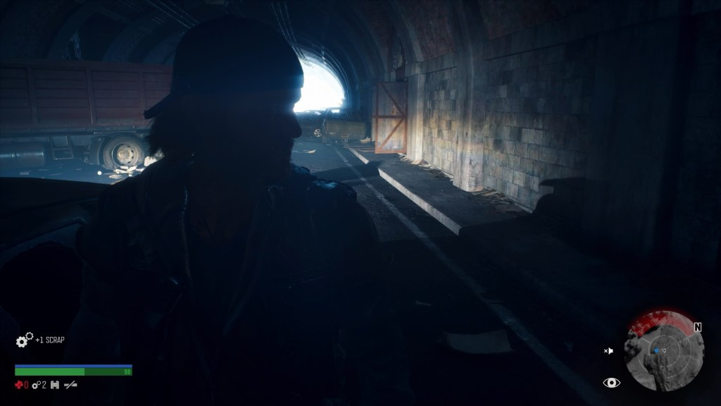 Deacon walking inside very dark tunnel filled with cars. Enemy radar shown on screen.