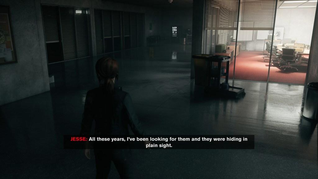 Jesse walking in a dark office area, image displays large subtitles.