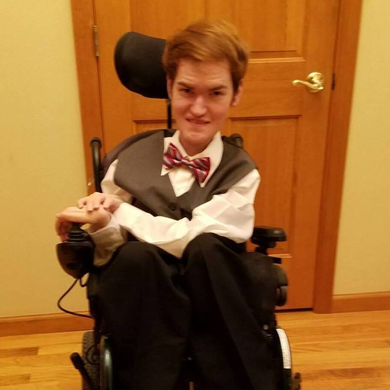 Grant in his wheelchair wearing an excellent bow tie