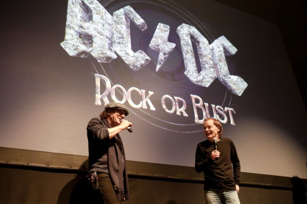"""NEW YORK, NY - NOVEMBER 18:  (L-R) Singer Brian Johnson and guitarist Angus Young of the band AC/DC attend the AC/DC """"Rock or Bust"""" CD Listening Party at Webster Hall on November 18, 2014 in New York City.  (Photo by JP Yim/Getty Images)"""