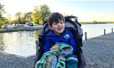 A little boy in a pushchair
