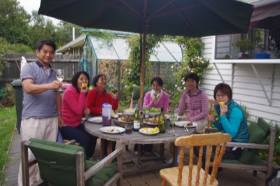 Guests enjoying BBQ dinner in the garden