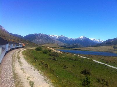 Tranz Alpine Train with Lake Sarah and mountain scenery