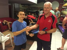 Tuesday 17th November 2015 : Club member Ken Ringrose presenting tonights joint winner Luke Egger with a movie voucher