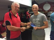 Tuesday 11th November 2015 : Club member Jerry Alderson presenting tonights joint winner Carlo Cottino with a movie voucher