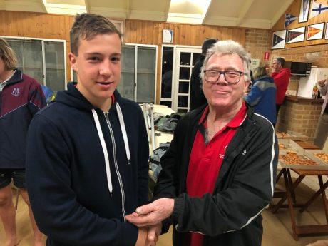 Tuesday 3rd September 2019 : Tonight's photo shows club member David Gardiner presenting tonight's winner Noah Boldy with $10 cash.