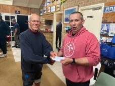 9th June 2020 : Tonight's photos shows club member John Reddell presenting David Boldy with a movie voucher