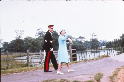 Queen Elizabeth walking over the bridge at the lower end of the lakes