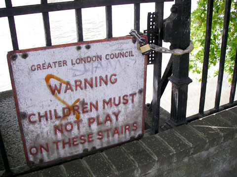 "Canoeing on the tidal Thames. Locked public steps down to the River Thames. A graffitied sign says ""Warning, Children Must Not Play on These Stairs""."