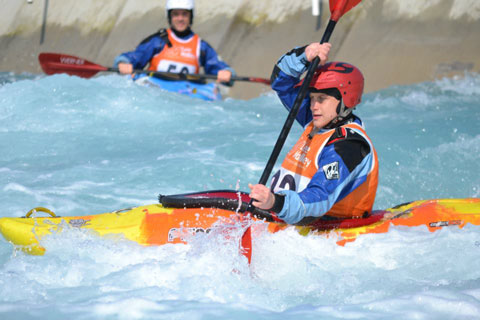 Two kayakers on white water canoe course
