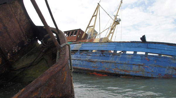Decaying boats at Hoo Salt Marsh