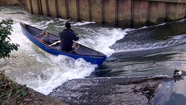 Canoe shooting the ramp weir on the Swift Ditch, Abingdon