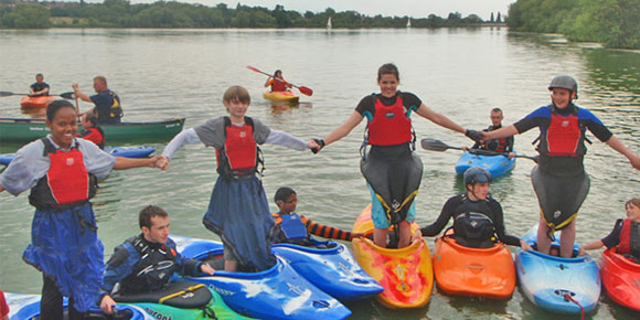 Summer fun for children at Camp Phoenix, one of many  clubs offering kayak and canoe activities during the summer holidays