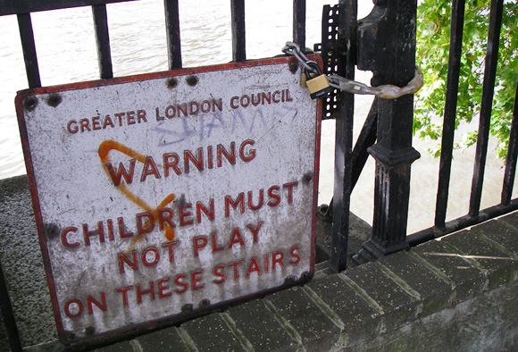 Stairs to the River Thames with padlocked gate.