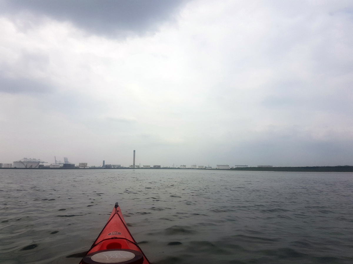 Sea kayaking around Canvey Island, looking towards Coryton Refinery