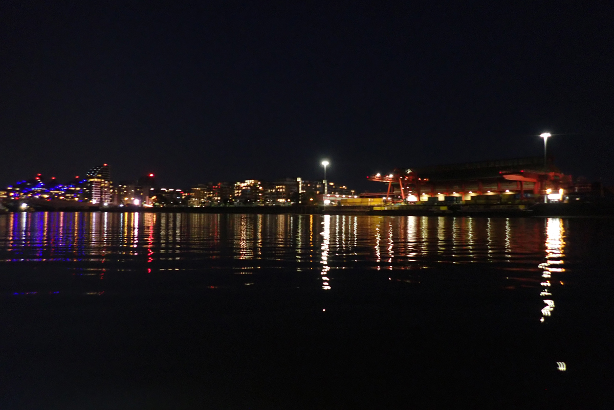 Broomhouse slipway at night, looking across the river, with the lights on the south bank reflecting in the water