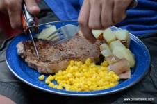 Rib eye meal on canoe camping trip